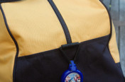 Blue SwaggerTag on Duffle Bag, Duffle Bag Tag